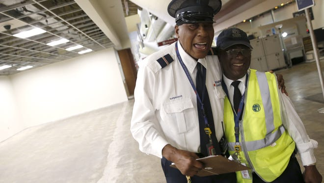 Ervin Johnson, left, and Patrick O'Neil laugh as they chat at the Tallahassee International Airport on Thursday, March 17, 2016. The day marked Johnson's 78th birthday and nearly 25 years employed as a skycap at the airport.