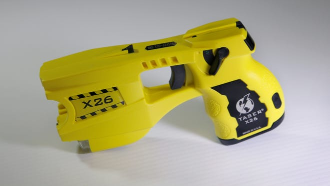 This Taser delivers a 50,000-volt shock at five-second intervals. File photo January 25, 2013.