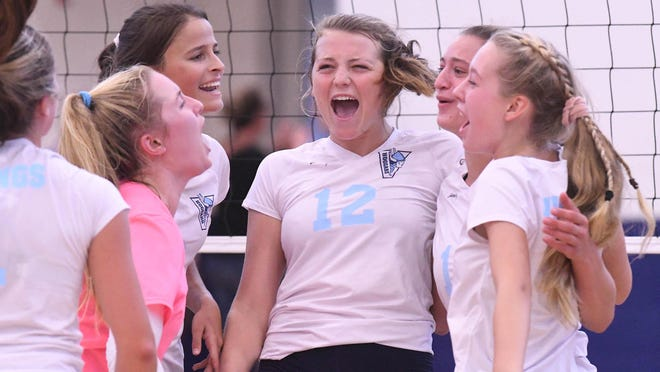 Hoggard players celebrate after scoring a point during a sweep over Ashley last year.