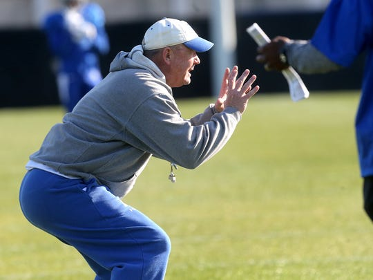 MTSU's football coach Rick Stockstill works with players