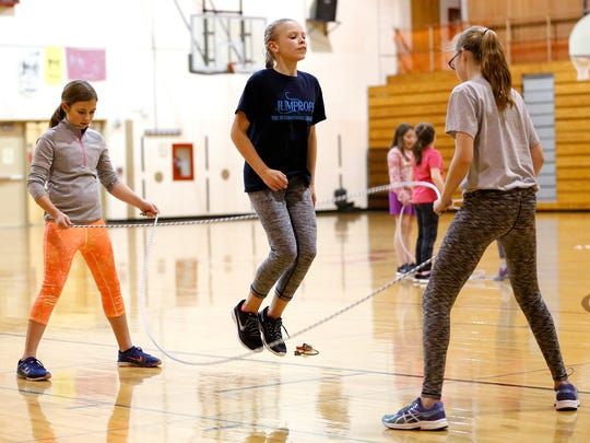 Autumn Freismuth, Sydney Howe and Amelia Bahr practice a jump rope routine during practice for the Fond du Lac Cardinal Skippers jump rope team.