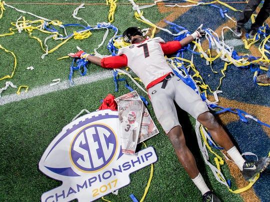Georgia outside linebacker Lorenzo Carter (7) celebrates after beating Auburn in the SEC Championship Game at Mercedes-Benz Stadium in Atlanta, Ga. on Saturday December 2, 2017. (Mickey Welsh / Montgomery Advertiser)