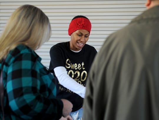 Tamarasah Smith sells her sweets Saturday, Dec. 16,