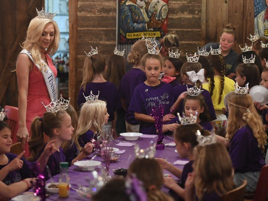 Miss Tennessee 2017 Caty Davis gave her last public speech to the 2018 Iris Princesses during an ice cream social, Saturday, June 23, at the Old Country Store.