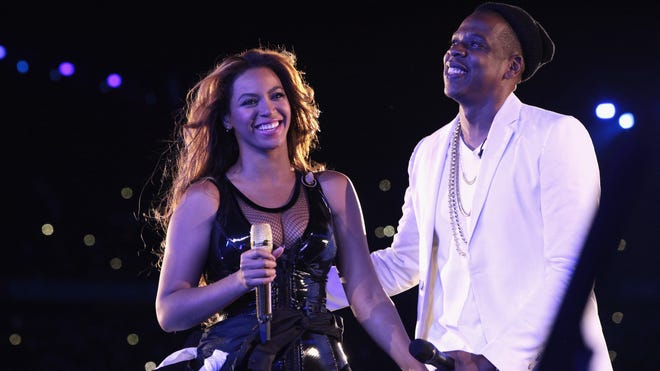 Beyonce and Jay Z perform during their On the Run tour at the Stade de France on Sept. 12, 2014, in Paris.