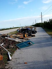 Trash piles along the Overseas Highway in the Florida