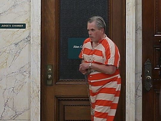 John Miller exits a courtroom at Allen Superior Court