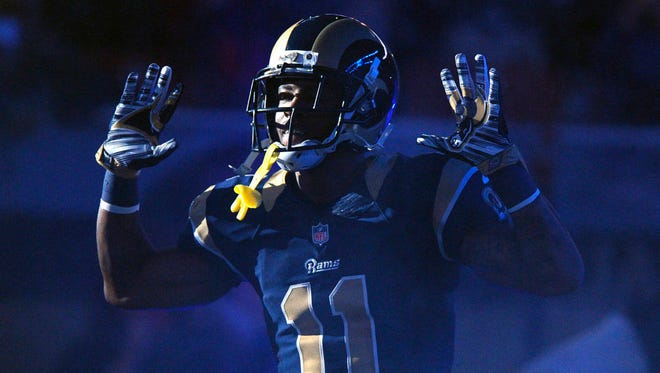 Nov 30, 2014; St. Louis, MO, USA; St. Louis Rams wide receiver Tavon Austin (11) puts his hands up to show support for Michael Brown before a game against the Oakland Raiders at the Edward Jones Dome.