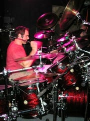 SideSlam drummer Marc Grossman bangs the skins during a performance at Dingbatz in Clifton.