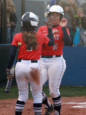 White House Heritage's Alex Martin greets Alyssa Arden (5) after Arden scored during a recent game.