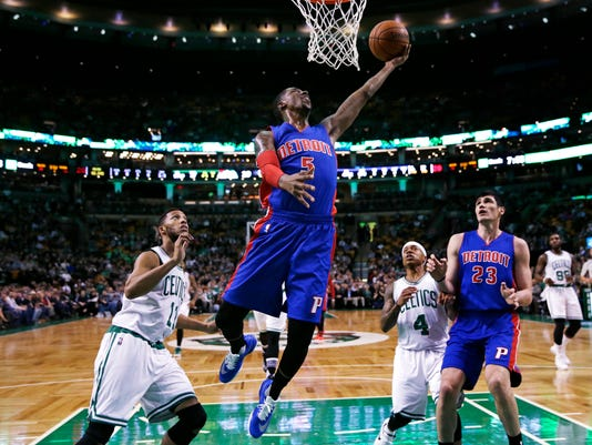 Detroit Pistons guard Kentavious Caldwell-Pope (5) lines up a dunk against the Boston Celtics during the first quarter of an NBA basketball game in Boston, Wednesday, Feb. 3, 2016. (AP Photo/Charles Krupa)