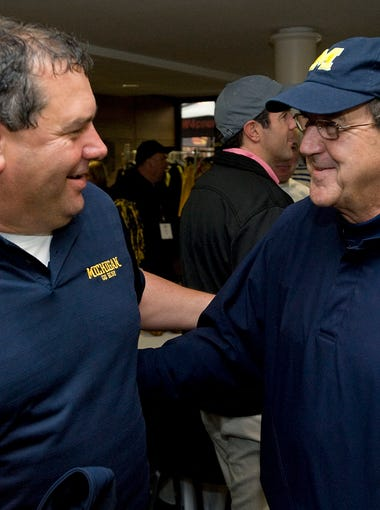U-M coach Brady Hoke left, talks to former coach and Hall of Fame inductee, Lloyd Carr, at the annual Griese/Hutchinson/Woodson Champions For Children's Hearts charity weekend at the University of Michigan Golf Course in Ann Arbor on May 15, 2011.