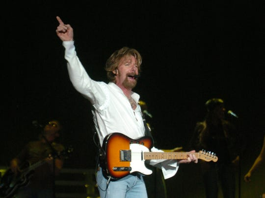 "Ronnie Dunn performs during ""The Long Haul Tour"" with Brooks and Dunn at the Verizon Wireless Music Center in Noblesville, IN Friday July 21, 2006."