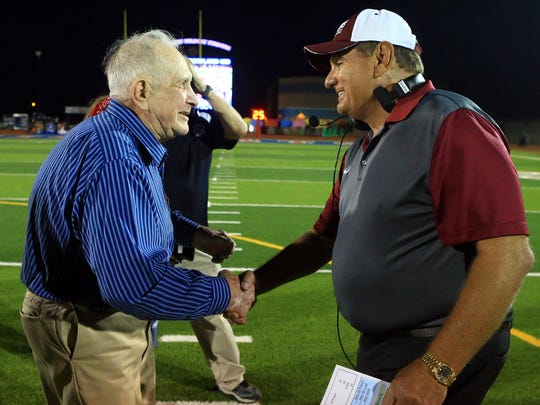 Gregory-Portland former head coach Ray Akins greets Calallen head coach Phil Danaher on Friday, Oct. 7, 2016, at Ray Akins Wildcat Stadium in Portland.