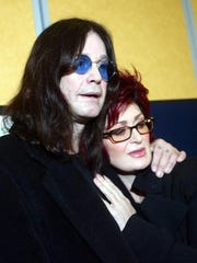 Rock star Ozzy Osbourne with his wife Sharon address a news conference at Beaconsfield, near London, Tuesday Nov. 23, 2004.