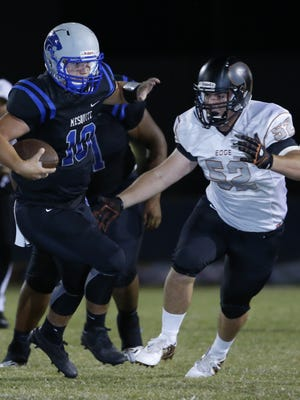 Mesquite's Wade Sapergia (10) runs before being tackled by Desert Edge's Dylan Scovil (52) at Mesquite High School on September 16, 2016 in Gilbert.