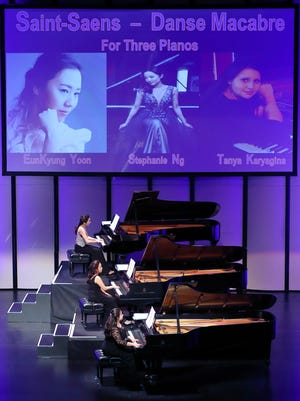 Pianists Eunkyung Yoon, Stephanie Ng, and Tanya Karyagina on stage at Three Pianos - Six Hands - One Performance.