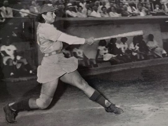 """Muskegon Lassies ballplayer Dorothy """"Mickey Maguire"""" Chapman batting during a game in 1948."""