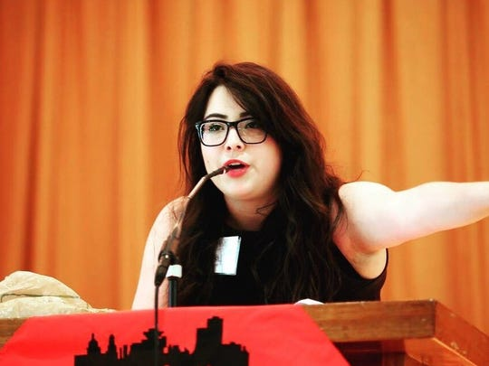 Brianna Casserly 18, speaks at the 2016 Metro Justice Annual Dinner at Temple B'Rith Kodesh in Brighton.