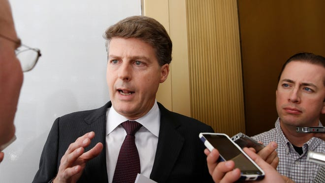 New York Yankees owner Hal Steinbrenner stops to talk to the media before attending a meeting of Major League Baseball's executive committee during baseball's owners meetings at MLB headquarters, Wednesday, May 18, 2016, in New York. Steinbrenner backed manager Joe Girardi and his coaching staff and has instead blamed players for the team's slow start. The Yankees are last in the American League East division at 16-22.