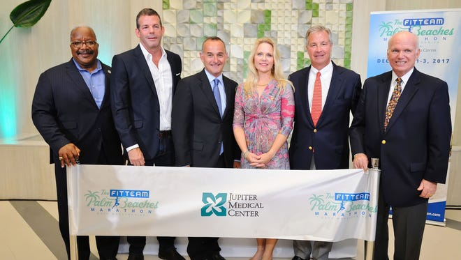 Keith James, Bobby Kreusler, Steven Seeley, Liv Vesely, Kenneth Kennerly and Dennis Grady take part Oct. 3 in a ribbon-cutting for Jupiter Medical Center Urgent Care, at 625 North Flagler Drive in West Palm Beach.