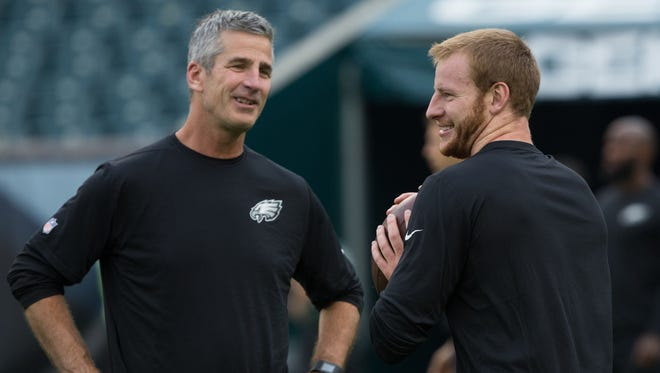 Philadelphia Eagles quarterback Carson Wentz (R) and offensive coordinator Frank Reich (L) prior to a game against the New York Jets at Lincoln Financial Field.