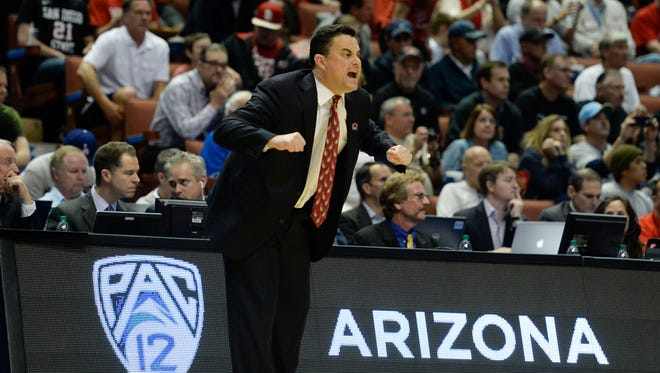 Mar 27, 2014: Arizona Wildcats head coach Sean Miller instructs against the San Diego State Aztecs during the first half in the semifinals of the west regional of the 2014 NCAA Mens Basketball Championship tournament at Honda Center.