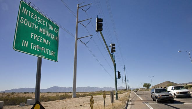 A city of Phoenix sign marks the proposed South Mountain Freeway extension at 24th Street and Pecos Road.