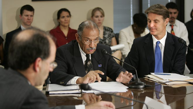 Sen. Evan Bayh, right, and Rep. John Conyers, Jr., center,  on Capitol Hill, Tuesday, July 18, 2006, in Washington. The lawmakers are hosting a forum on the crisis facing the U.S. auto industry.