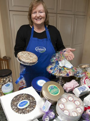 Barbara Schechter shows some of the products she sells through Barbara's Cookie Pies.