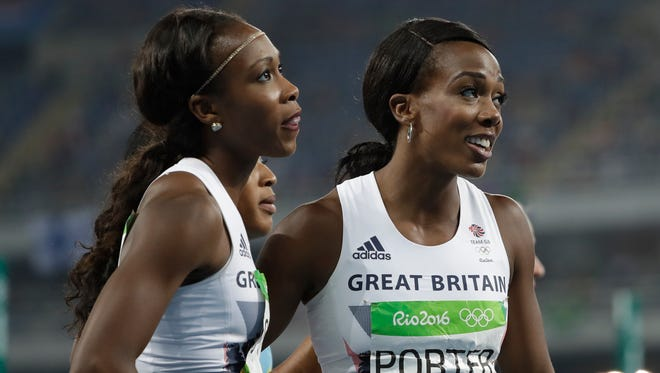 Britain's Tiffany Porter, right, and Britain's Cindy Ofili after competing in the women's 100-meter hurdles final during the athletics competitions of the 2016 Summer Olympics.