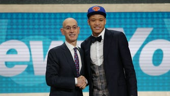 Kevin Knox (Kentucky) greets NBA commissioner Adam Silver after being selected as the number nine overall pick to the New York Knicks in the first round of the 2018 NBA Draft at the Barclays Center.