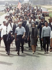 Rev. Martin Luther King with his wife Coretta Scott King participate in the march from Montgomery, Ala., to the state capitol on March 19, 1965.