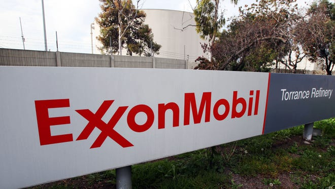 File photo taken in 2012 shows the sign for  Exxon Mobil's Torerance Refinery in Torrance, Calif.