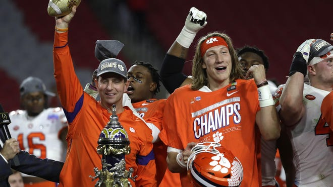 Clemson coach Dabo Swinney and quarterback Trevor Lawrence celebrate following the Tigers' victory over Ohio State in the college football semifinal game in the Fiesta Bowl on Dec. 28. (AP Photo/Rick Scuteri).