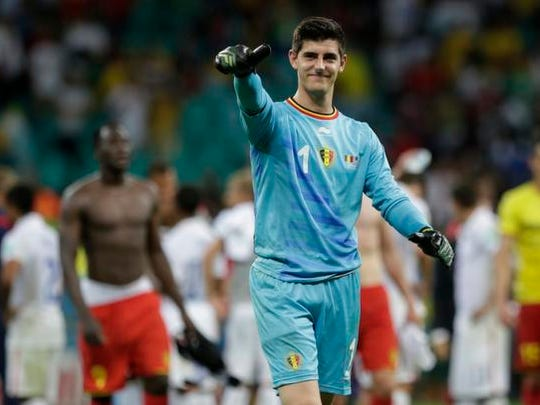 Belgium's goalkeeper Thibaut Courtois gestures after the World Cup round of 16 soccer match between Belgium and the USA at the Arena Fonte Nova in Salvador, Brazil, Tuesday, July 1, 2014. Belgium won the match 2-1 after extra-time. (AP Photo/Julio Cortez)