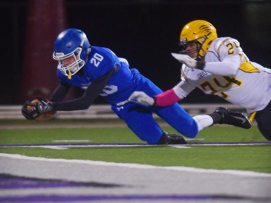 Sioux Falls Christian's Parker Nelson attempts to make a touchdown during the game against Groton Area Thursday, Oct. 26, at Bob Young Stadium in Sioux Falls.