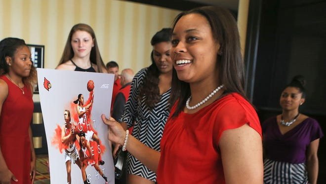 U of L freshman Asia Durr smiles while holding a team poster after a basketball luncheon prior to the 2015-16 season. Durr is U of L's highest-rated recruit in women's basketball history. She chose Louisville over Maryland, Duke, Tennessee, Baylor and Notre Dame. Oct. 14, 2015