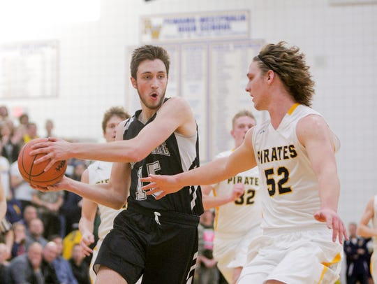 Dansville junior Caleb Hodgson drives to the basket