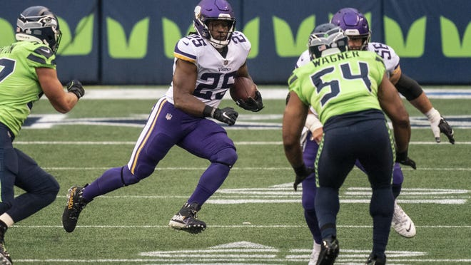 Minnesota Vikings running back Alexander Mattison runs with the ball against the Seattle Seahawks last Sunday in Seattle. Mattison can have a big fantasy performance against the Falcons this week.