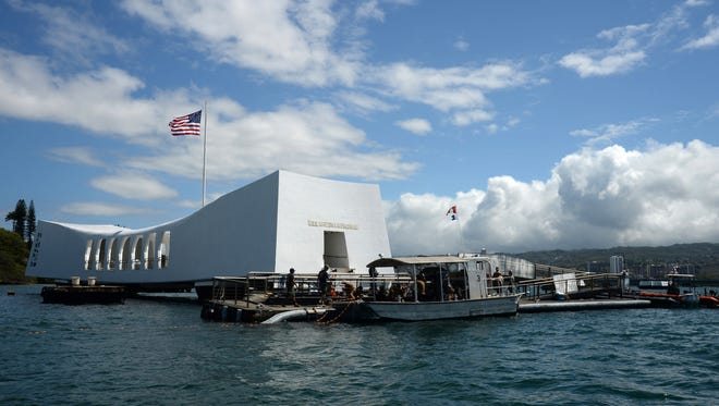 FILE- In this June 3, 2015 file photo released by the U.S. Navy, sailors work to repair the floating dock next to the USS Arizona Memorial in Pearl Harbor, Hawaii, after the USNS Mercy hospital ship struck the memorial's dock in May as it was leaving Pearl Harbor.  Japan's leader says he will visit Pearl Harbor with U.S. President Barack Obama at the end of this month. Prime Minister Shinzo Abe said Monday, Dec. 5, 2016, he will visit Hawaii in late December and hold a final summit meeting there with Obama before the American leader leaves office. (Laurie Dexter/The U.S. Navy via AP, File)