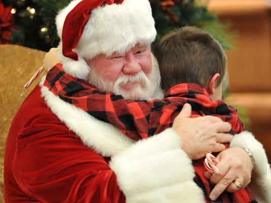 Santa Claus visits local bank lobby