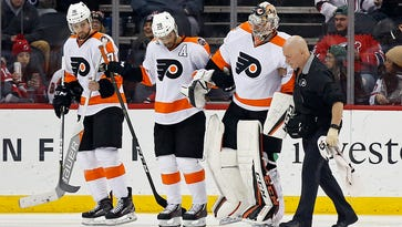 Mason leaves hurt as 'flat' Flyers blown out by Devils