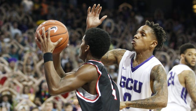 GCU redshirt senior guard DeWayne Russell (0) blocks a shot by Seattle freshman guard Morgan Means (1) in the first half at GCU Arena in Phoenix on Saturday, Jan. 21, 2017.