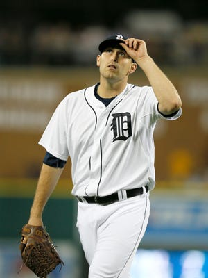Detroit Tigers starting pitcher Matt Boyd touches his hat and looks to the sky as he walks to the dugout after getting the final out of the seventh inning with a 2-1 lead over the Kansas City Royals on Wednesday, August 5, 2015, in Detroit.