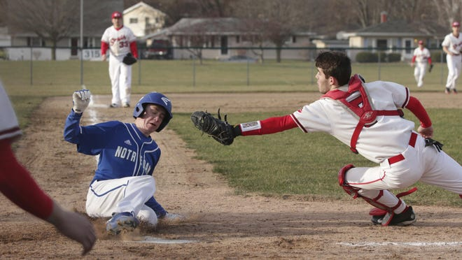 Green Bay Notre Dame's Noah Duncan eludes the tag of Sheboygan South's Ben Souik at home against on Thursday.