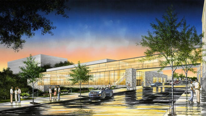 A drawing depicts the proposed Fox Cities Exhibition Center across Lawrence Street from the rear of the Radisson Paper Valley Hotel in Appleton.