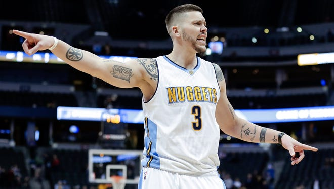 Denver Nuggets guard Mike Miller (3) motions in the fourth quarter against the Dallas Mavericks at the Pepsi Center. The Nuggets won 110-87.