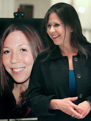 Margie Weiss stands in front of a portrait of her daughter, Rachel Hoffman during a press conference inside the Capitol rotunda on Thursday, January 8, 2008. She was hoping to help get Rachel's  Law passed, to help put guidelines in place to prevent the murder of confidential informents, like her daughter.