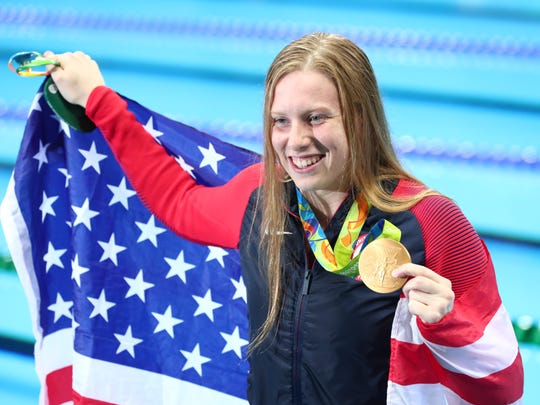Aug 8, 2016; Rio de Janeiro, Brazil; (Editors note: Caption correction) Lilly King (USA) poses with an American flag and her gold medal after the women's 100m breaststroke final during the Rio 2016 Summer Olympic Games at Olympic Aquatics Stadium. Mandatory Credit: Rob Schumacher-USA TODAY Sports